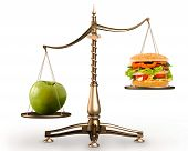 stock photo of junk food  - Big green ripe apple and junk food hamburger on scales isolated white background - JPG