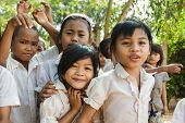 SIEM REAP, CAMBODIA, DECEMBER 04 : Cambodian students are posing in front of the school in a village
