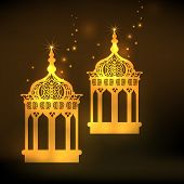 Golden intricate arabic lanterns on brown background for holy month of Muslim community Ramadan Mubarak.
