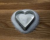 Heart Shape Cookie Mold On A Wood And Sugar