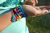 Seawater crab and girl wearing loom band bracelets