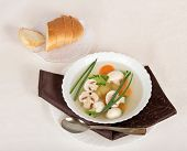 Mushroom soup, bread, spoon and napkin