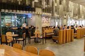 SHENZHEN, CHINA-APRIL 13: Starbucks Cafe interior on April 13, 2014 in Shenzhen, China. Starbucks Co