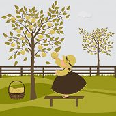 Cute Girl In The Orchard With Apple Trees