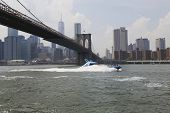 Shark Speedboat under Brooklyn Bridge