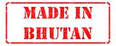 Made in Bhutan on Red Rubber Stamp.