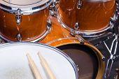 image of drum-kit  - Two drumsticks on top of a drum kit - JPG