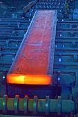 hot steel on conveyor inside of steel plant