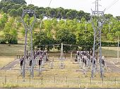 stock photo of transformer  - power plant with pylons and transformers overhead view - JPG