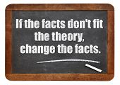 if the facts do not fit the theory, change the facts - a quote from Albert EInstein -  white chalk text  on a vintage slate blackboard