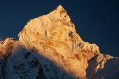 Scene Of Sunset On Mountain Peaks