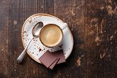Espresso Cup With Chocolate On Wooden Background