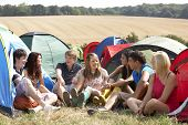 stock photo of sleeping bag  - Young people on camping trip - JPG