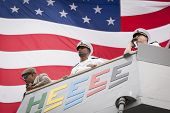 STATEN ISLAND, NY - MAY 21, 2014: The American Flag flies behind the harbor master, commander, and c