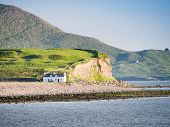 stock photo of beach-house  - An image of a house at the coast in Ireland - JPG