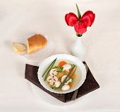 Mushroom soup, bread slices and tulips
