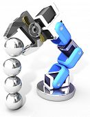 Robot arm building growth in technology business as ball bearings stack