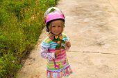 Little Girl In A Motorcycle Helmet