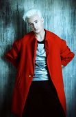 Portrait of a fashionable male model with blond hair. Men's beauty, fashion.