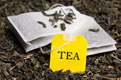stock photo of tea bag  - close up picture of two tea bags and dried grey tea leaves - JPG