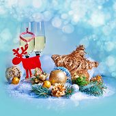 New Year and Christmas Celebration .Two Champagne Glasses in Holiday decoration.