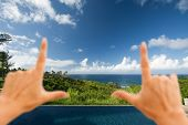 Hands Framing Breathtaking Hawaiian Ocean View Deck And Pool