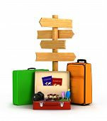 wood sign board and travel bags passports, glasses and camera