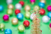 Christmas tree toy over defocused background