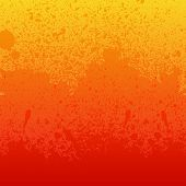 Colorful red, orange and yellow paint splashes background