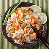 Rice Noodles With Chicken, Shrimp And Vegetables Closeup