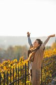 Happy Young Woman In Autumn Outdoors Rejoicing