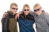 Three friends in sunglasses. Two of the boys twin brothers.