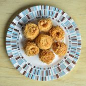 picture of baklava  - Birds nest baklava dessert with peanuts on wooden table - JPG