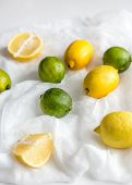 Lemons And Limes On The White Background