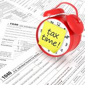 Tax Form And Red Alarm Clock