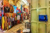 JERUSALEM, ISRAEL - JULY 13, 2014: Typical gift shop on bazaar in Old City of Jerusalem with variety of traditional souvenirs. It is very popular with tourists and pilgrims visiting Holy Land.
