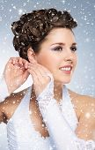 Young and beautiful bride over winter background