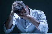 pic of depressed  - Portrait of young depressed man in pain - JPG