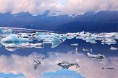 Icebergs and ice floes in the blue lagoon Ice Jokulsarlon. South-east Iceland in July