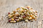 mixture of legumes on old wooden table