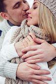Amorous guy embracing his girlfriend