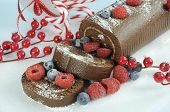Christmas Holiday Chocolate Roulade Swiss Roll With Berries Dessert Party Food - Closeup.