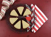image of shortbread  - Christmas shortbread triangle cookies on vintage baking rack on dark red rustic wood background with festive decorations - JPG