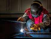 Worker Work Hard With Welding Process