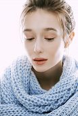 beauty young blond woman in scarf with weathered lips close up isolated