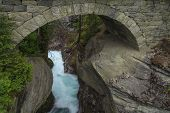 Falls Under The Beautiful Old Stone Bridge