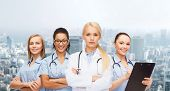 medicine and healthcare concept - team or group of female doctors and nurses