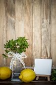 Mint In A Glass Vase, Lemons And Mini Easel With Blank Canvas