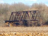 pic of trestle bridge  - a steel railroad bridge alongside a farmers field - JPG