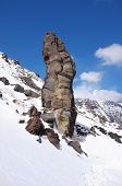 magmatic rock formation in a snowy slope of Etna Park, Sicily